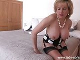Look at this busty burning mature in lingerie