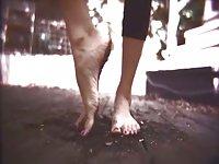 Dirty tart gives footjob