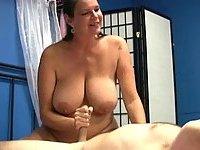 Big tits brunette gives handjob