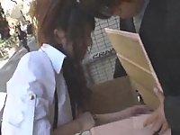 Amateur Japanese girl gives public handjob