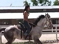 Naked Asian girl riding horse