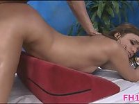 Gorgeous teen drilled on massage table