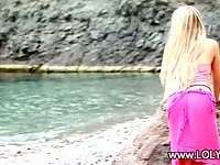 Blonde girl stripping on the beach