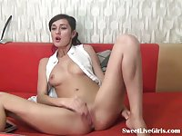 Hot brunette masturbating on a red couch scene 1