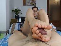 Mature brunette makes bedroom oily footjob