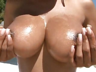 Busty black babe masturbating outdoors